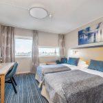 Anker hotellin standard-luokan huone erillisillä vuoteilla